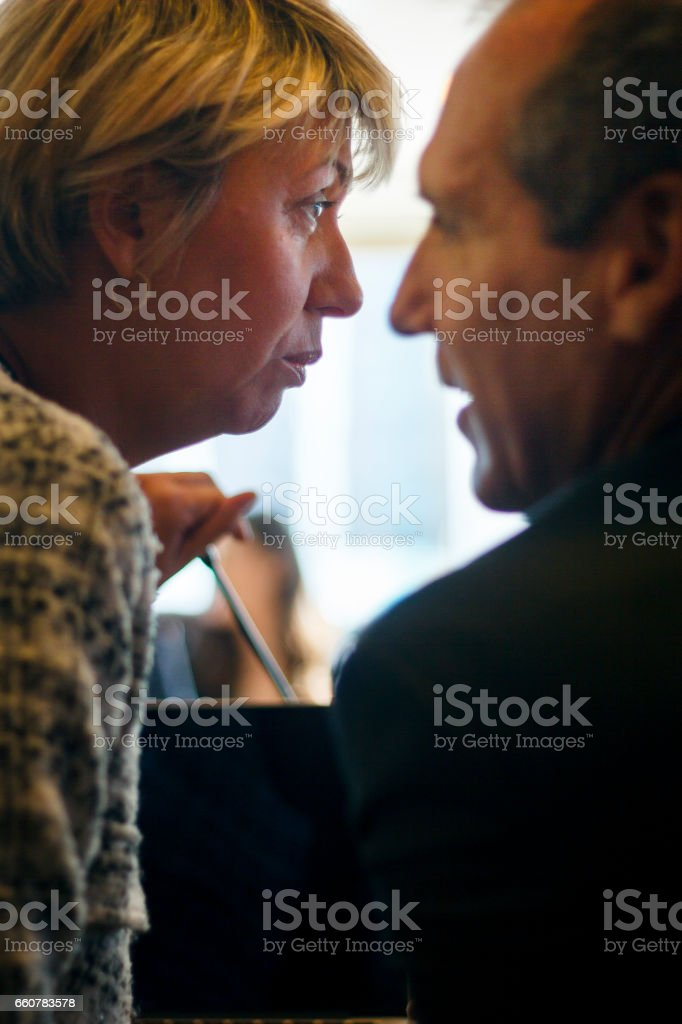 Business woman whispering in a meeting room. stock photo