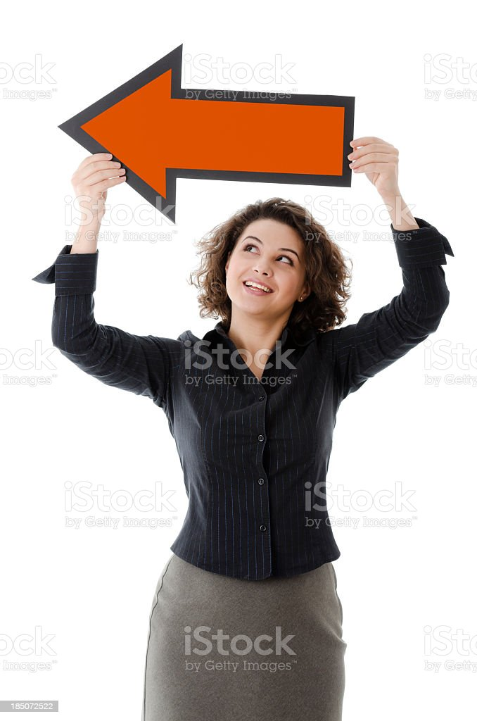Business woman with a big arrow, pointing side, isolated royalty-free stock photo