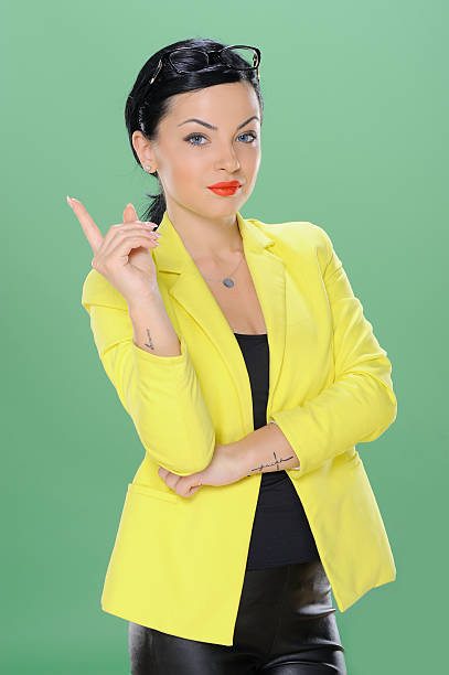 Business woman with a friendly expression isolated on chroma green stock photo