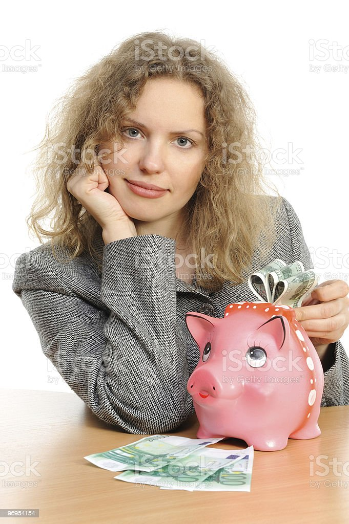 Business woman with a piggy bank royalty-free stock photo