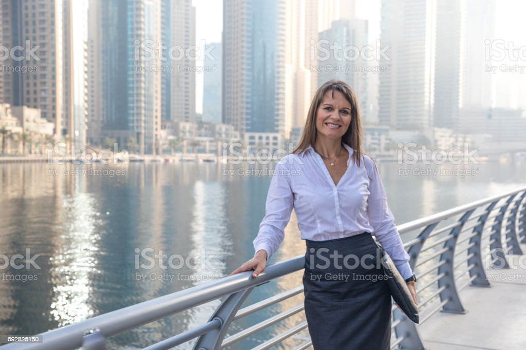 Business woman with a portfolio on a boardwalk. stock photo