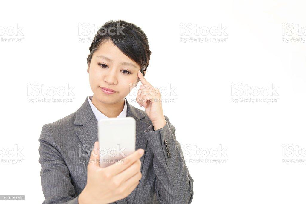 Business woman with an uneasy look photo libre de droits
