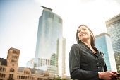istock business woman with arm crossed on urban scene 628664102