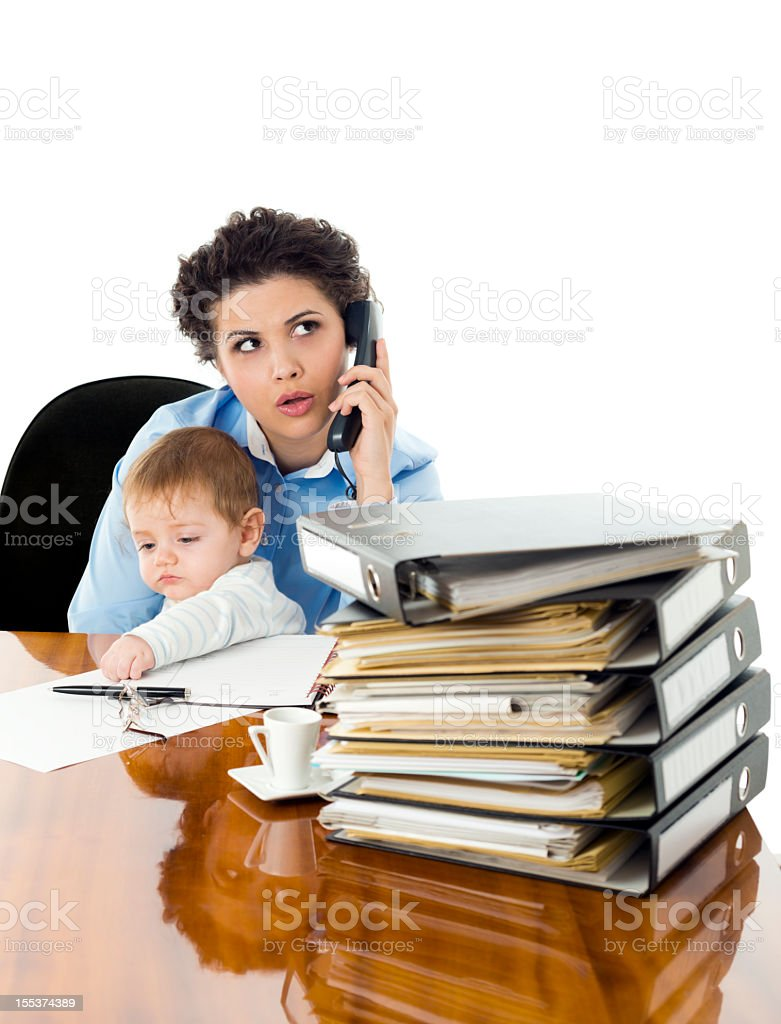 Business woman with baby in her arms, and paperwork royalty-free stock photo