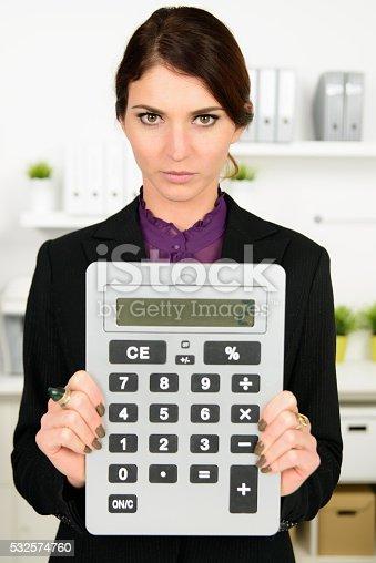 istock business woman with big calculator 532574760