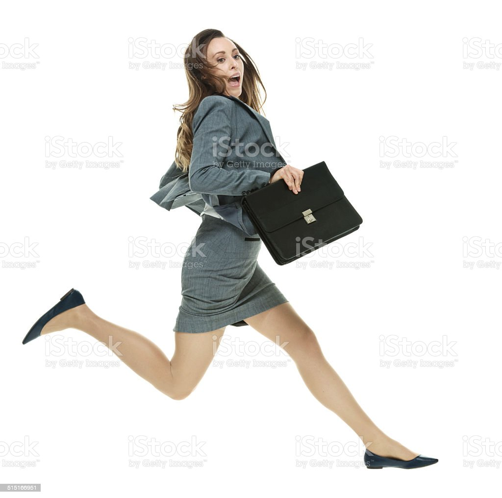 Business woman with briefcase running stock photo