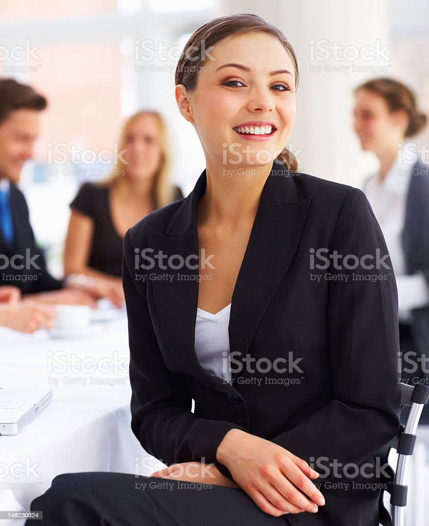 Business woman with colleagues at the back royalty-free stock photo
