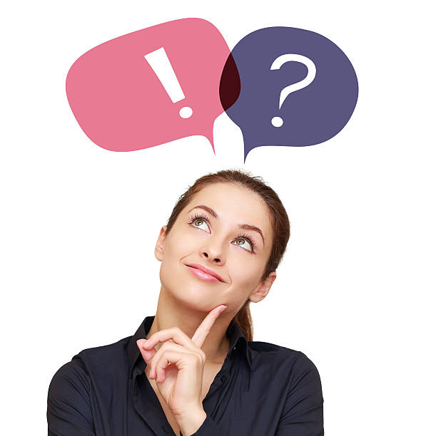 Business woman with colorful question mark and exclamation in balloons stock photo