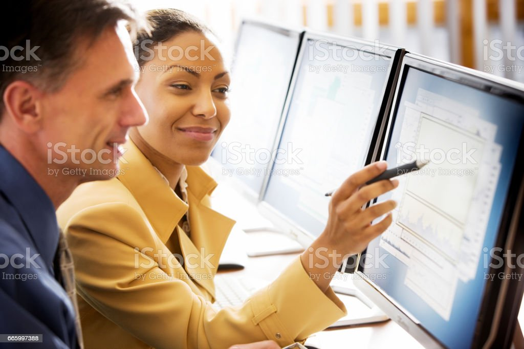 Business Woman with Co-Workers stock photo