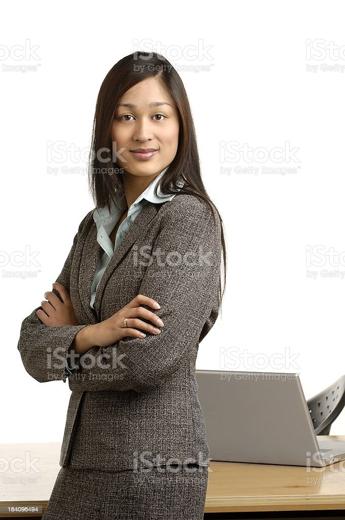 Business woman with desk and laptop on white royalty-free stock photo