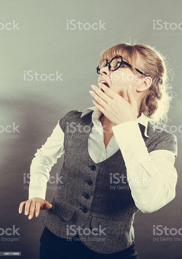 Business woman screaming looking upward in full fear wide open mouth...