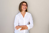 business woman with glasses smiling