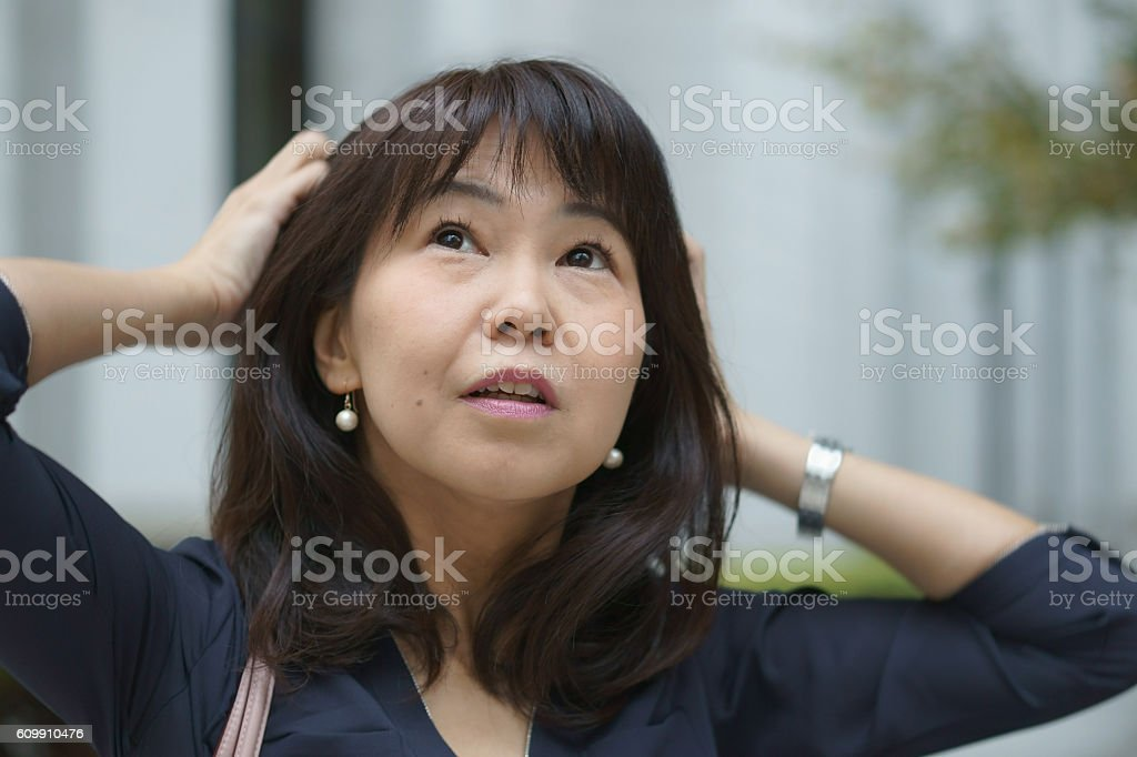 business woman with hands on head stock photo