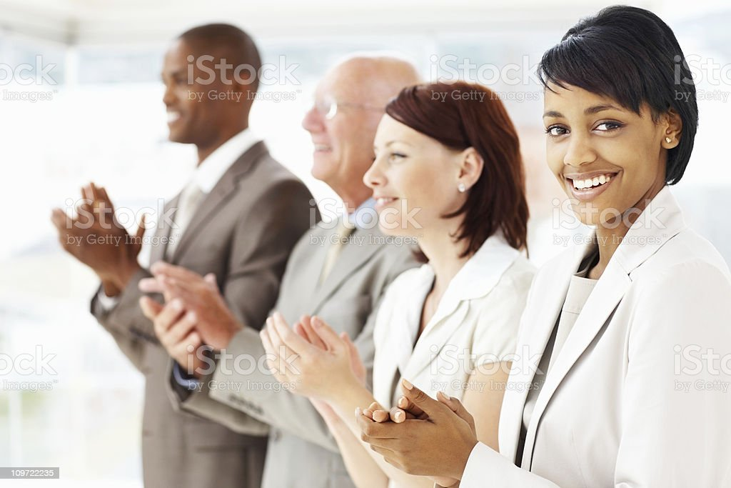 Business woman with her team clapping for a good presentation royalty-free stock photo