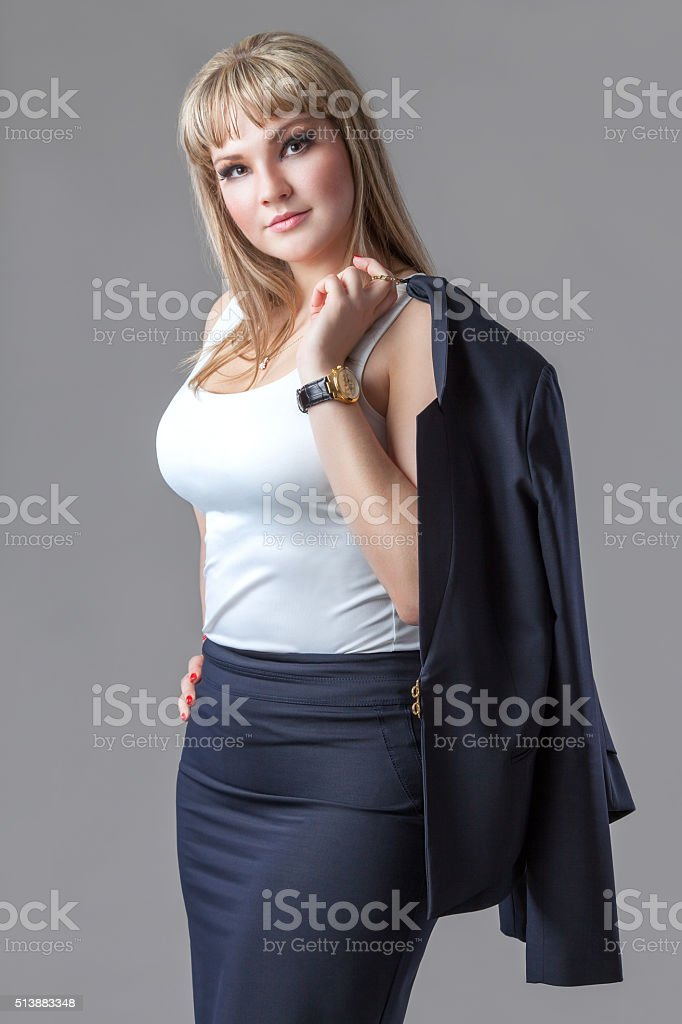 Business woman with  jacket on a gray background stock photo