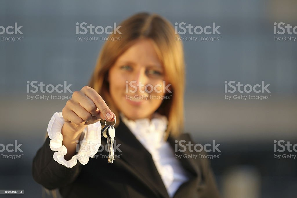 Business woman with keys royalty-free stock photo