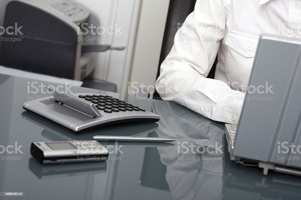 Business woman with mobile phone, calculator and notebook royalty-free stock photo