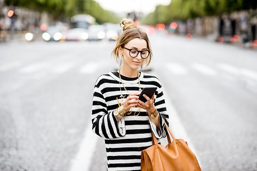 istock Business woman with phone on the street 839413542