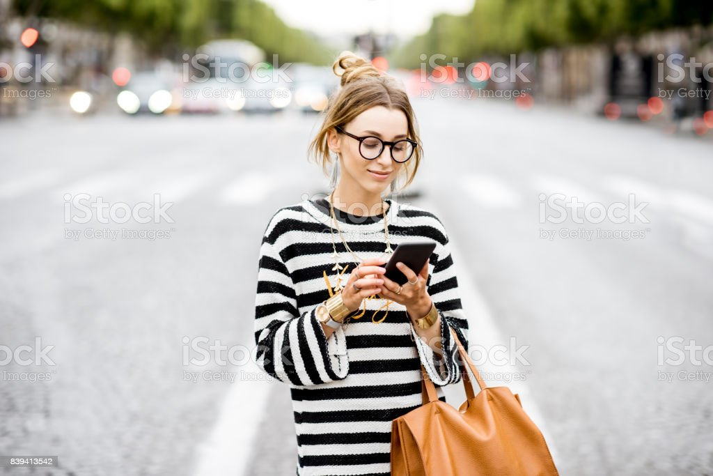 Business woman with phone on the street stock photo