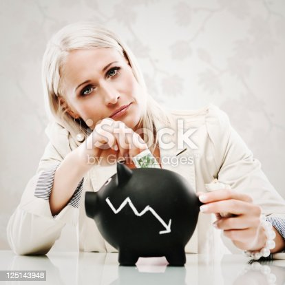 istock Business woman with piggy bank 125143948