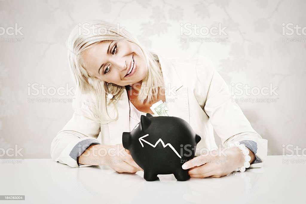 Business woman with piggy bank royalty-free stock photo