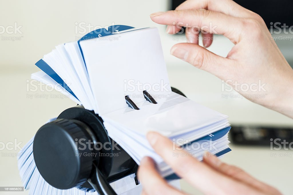 Business woman with Rolodex stock photo