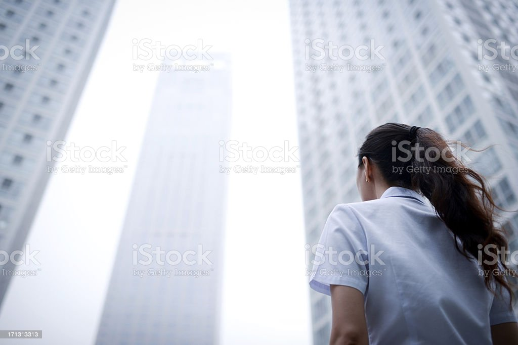 Business Woman with Skyscraper Office Building Background - XXXXXLarge stock photo