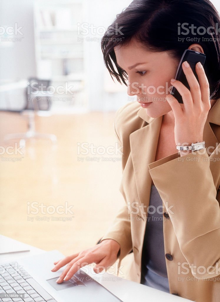Business woman with telephone and laptop royalty-free stock photo