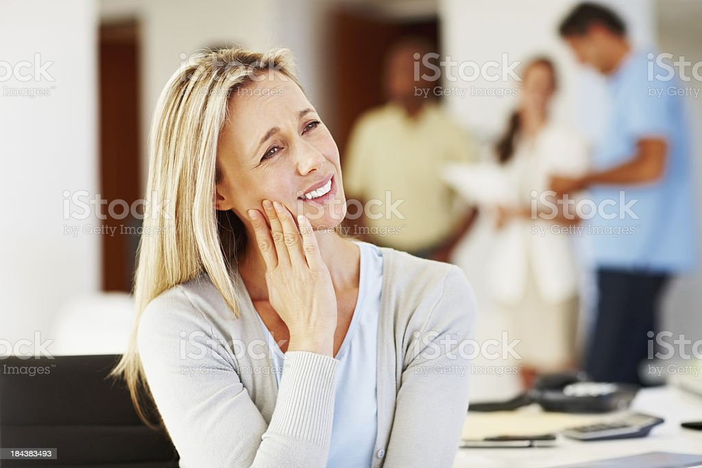 Business woman with toothache stock photo