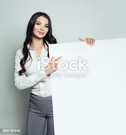 Clever business woman with empty white blank paper banner background. Young woman smiling, business and education concept