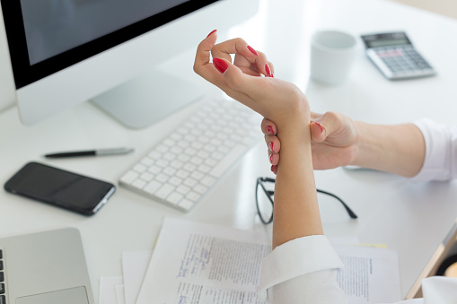 istock Business woman with wrist pain 1017580686