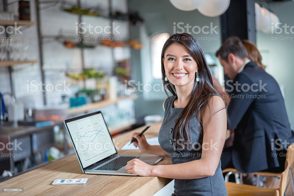 Business woman working at a cafe stock photo