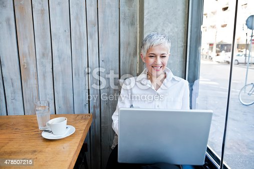 istock Business woman working at cafe 478507215