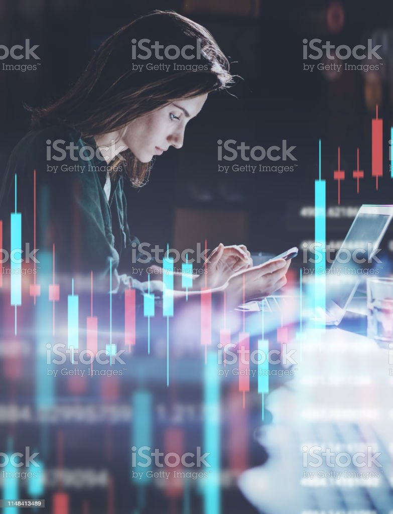 Business woman working at night office in front laptop computer with...