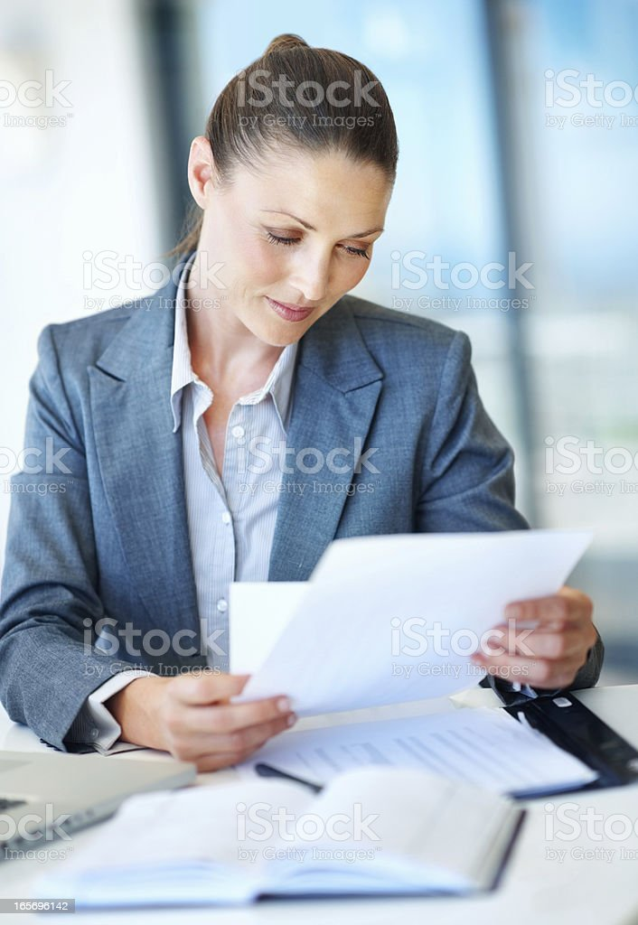 Business woman working at office desk royalty-free stock photo