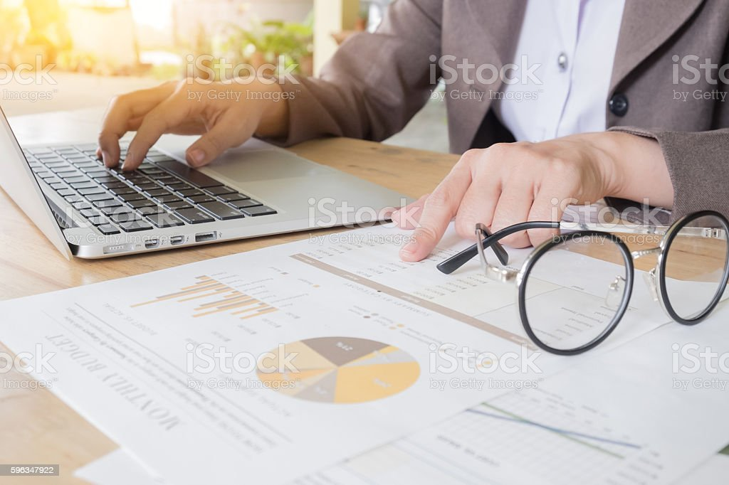 Business woman working at the office. analysis document and usin royalty-free stock photo