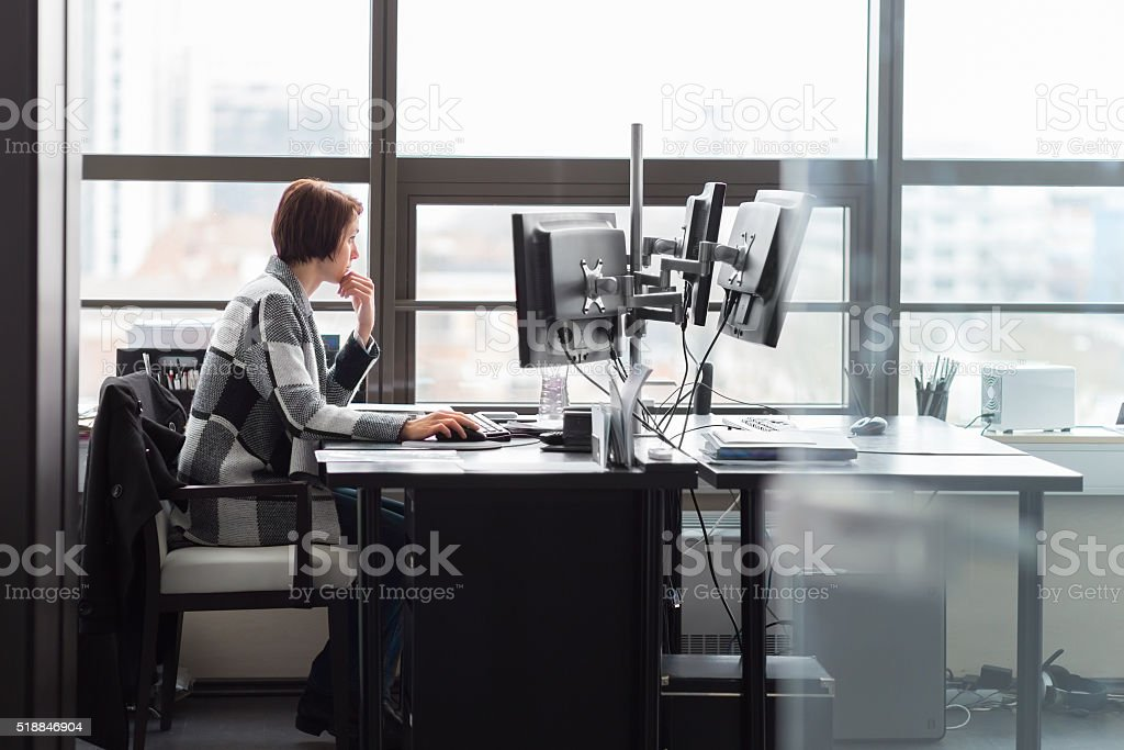 Business woman working in corporate office. royalty-free stock photo