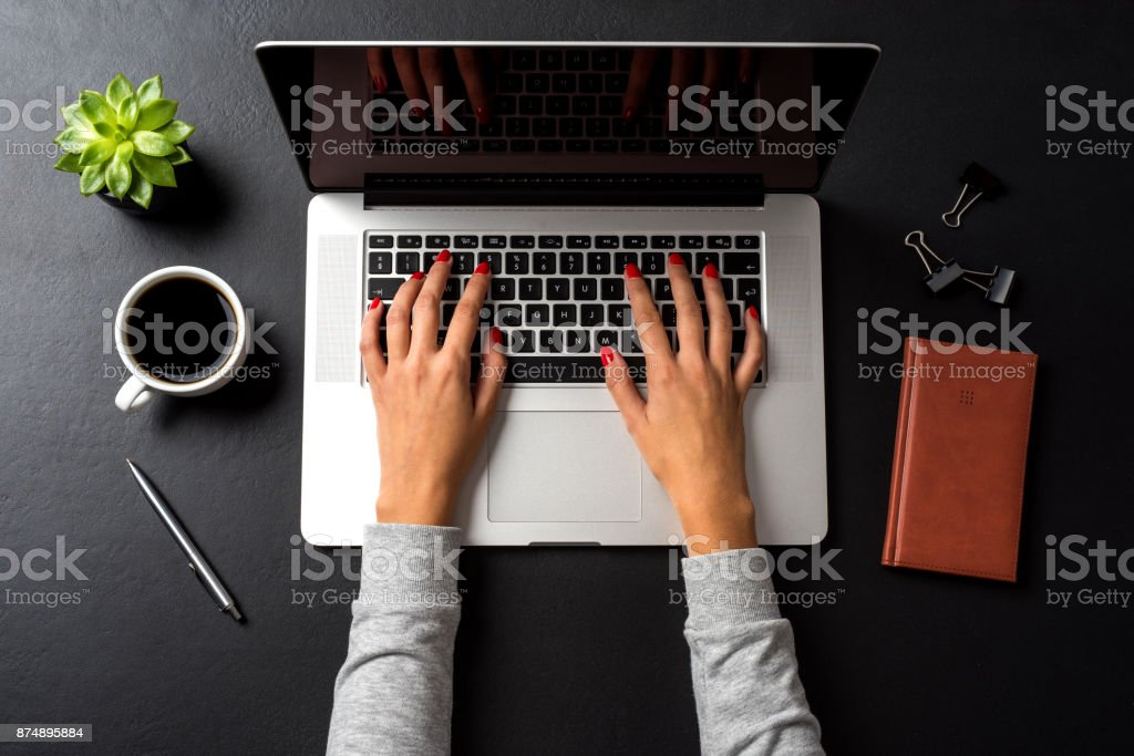 Business woman working in office Business woman working in office Above Stock Photo
