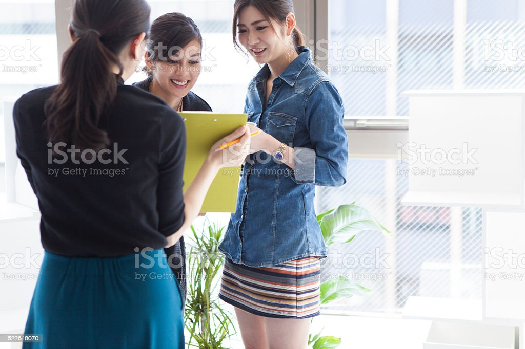 Business woman working in the office stock photo