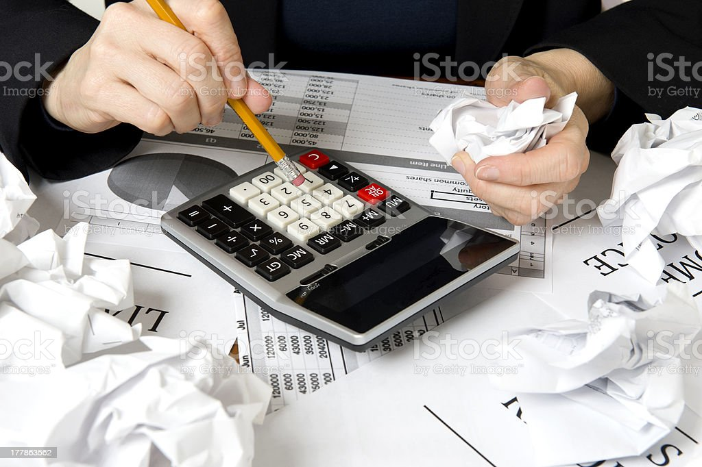 Business woman working on a calculator royalty-free stock photo