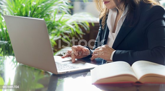 663458084 istock photo Business woman working on a laptop. Business, legal law, advice and justice concept. Selective focus. 927591704