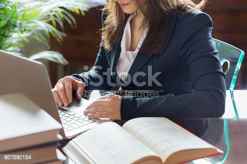 663458084 istock photo Business woman working on a laptop. Business, legal law, advice and justice concept. Selective focus. 927592134