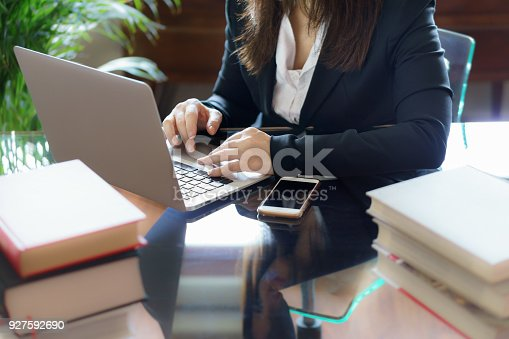 663458084 istock photo Business woman working on a laptop. Business, legal law, advice and justice concept. Selective focus. 927592690