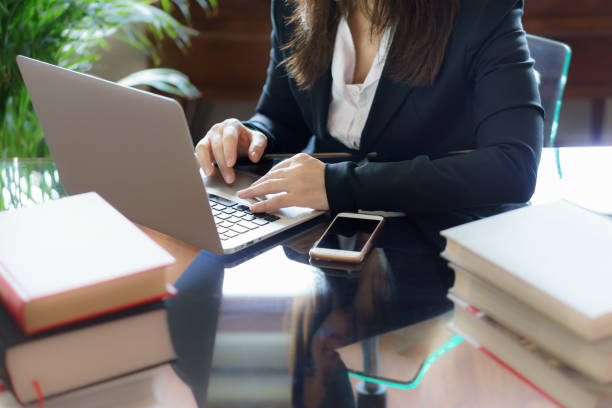 Business woman working on a laptop. Business, legal law, advice and justice concept. Selective focus. Business woman working on a laptop. Business, legal law, advice and justice concept. Selective focus. jurist stock pictures, royalty-free photos & images