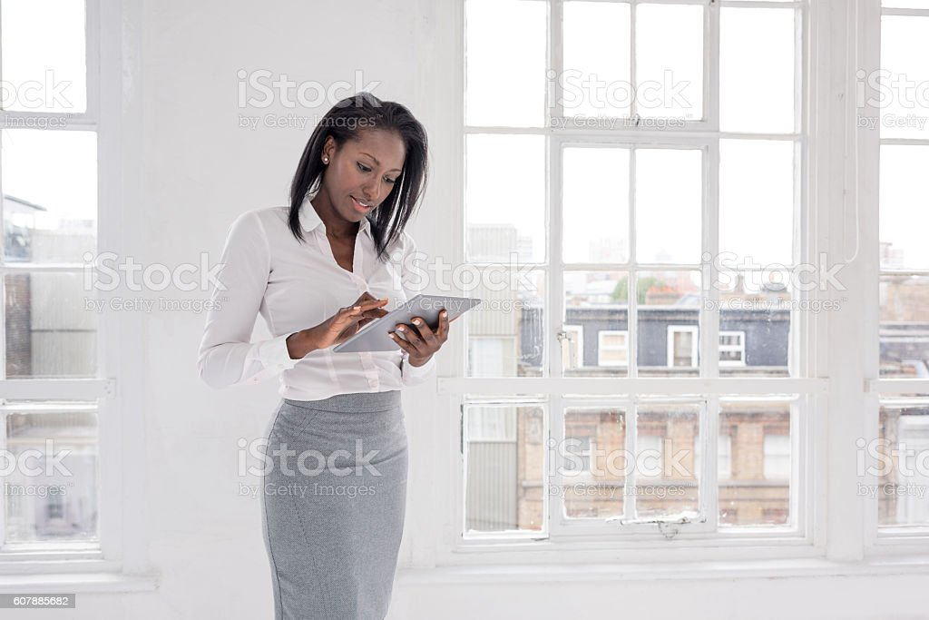 Business woman working on a tablet computer stock photo