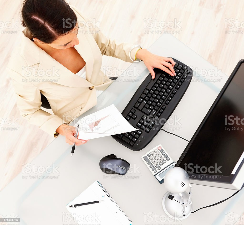 Business woman working on computer at desk royalty-free stock photo