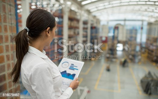 istock Business woman working on freight transportation 516079462