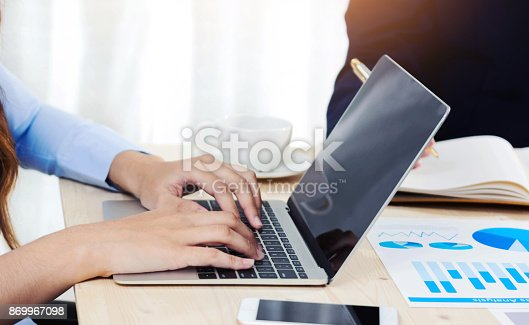 954578184 istock photo business woman working on laptop 869967098