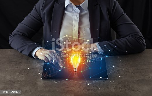 497982910 istock photo Business woman working on tablet with new idea concept 1201658972