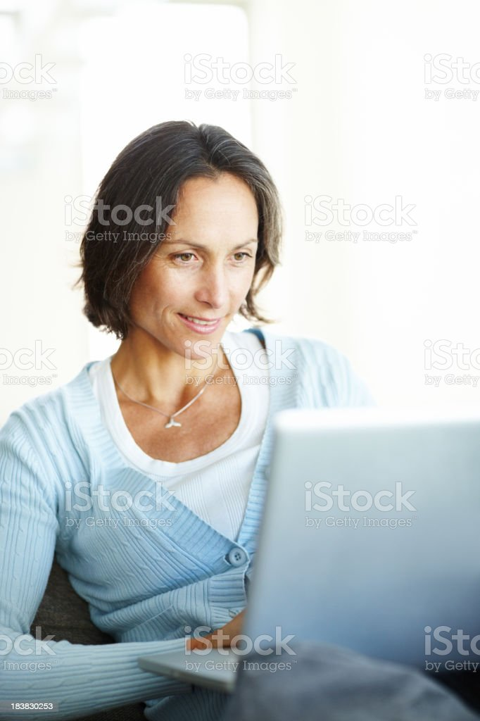 Business woman working on the laptop from home royalty-free stock photo